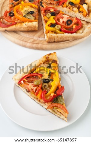 slices of vegetable pizza on white background