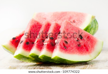 slices of watermelon on wooden table - stock photo
