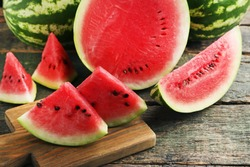 Slices of watermelons on cutting board