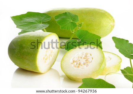 Slices of wax gourd on white background