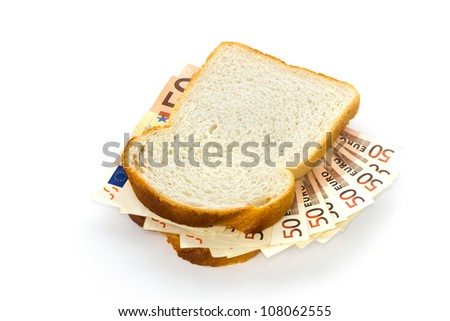 Slices of white bread with 50 euro bills sandwich filling