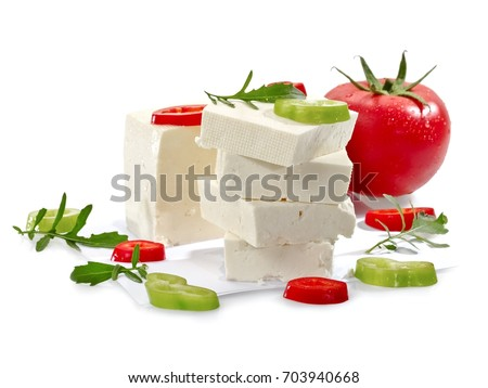 Slices of white cheese and peppers and a tomato