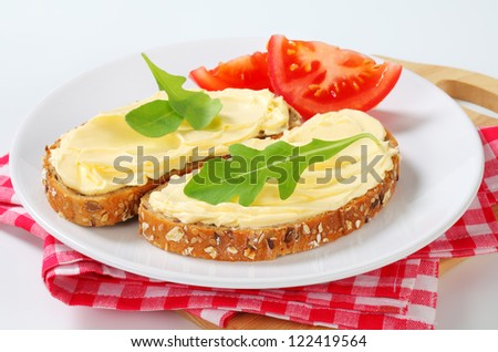 Slices of whole grain bread with butter