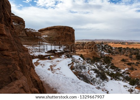 Slick rock section covered in ice and snow making it a dangerous section of the hike to Delicate Arch