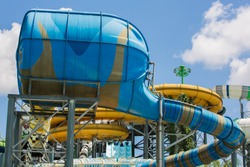 Slider and pool at waterpark in summer