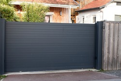 sliding gate steel big grey metal portal fence on modern house street