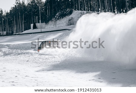 Sliding on an ice line. Snow drifting. snowy land road at winter stock photo
