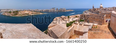 Sliema and Old town of Valletta with fortress, Our Lady of Mount Carmel church and St. Paul's Anglican Pro-Cathedral at sunset, Capital city of Malta Stock photo ©