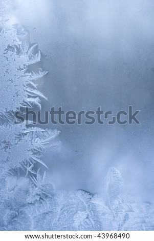 Slightly blurred beautiful frostwork on a window glass (with empty space on the right for your text or image)