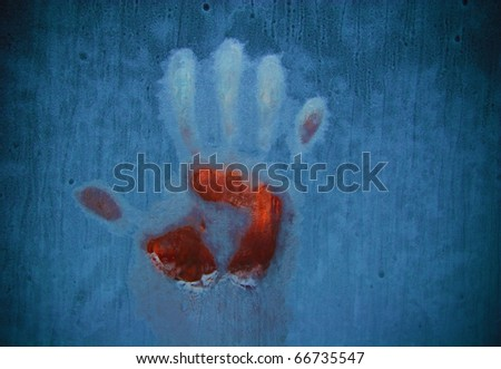 Slightly blurred bloody handprint on a frozen window (symbolizing horror or fear)