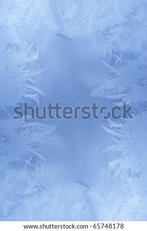 Slightly blurred frost pattern on a window glass (with empty space for your text or image)