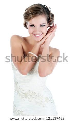 Slim beautiful woman wearing luxurious wedding dress. Bride