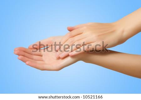 slim female hand on blue background