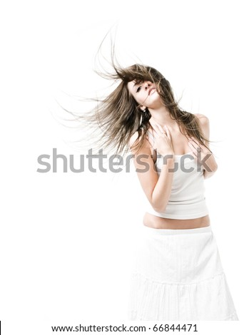 Slim girl in white top and skirt with loose flying hair