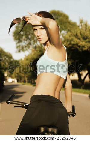 slim girl on bicycle outdoors