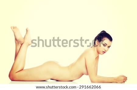 Slim naked woman lying down