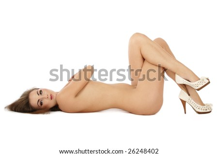 stock photo : Slim sexy naked woman in high-heeled shoes lying on white ...