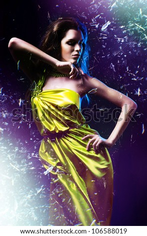 slim sexy woman in green dress and shuttered glass