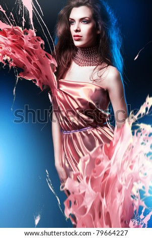 slim sexy woman in pink dress with long hair and paint splash