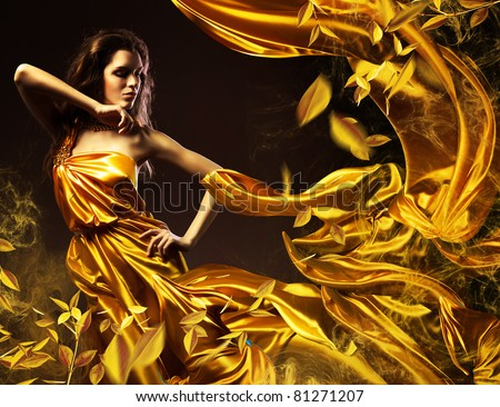 slim sexy woman in yellow fabric and leaves