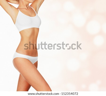 Slim woman against abstract background with circles and copyspace