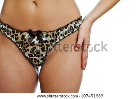 Slim woman body in leopard panties. Isolated on white background.