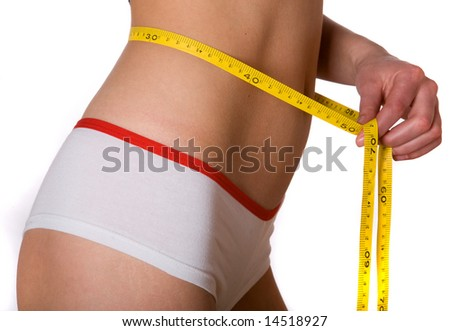 slim woman with measuring tape on belly