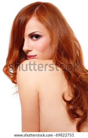stock photo : Slim young sexy girl with long red hair on white background