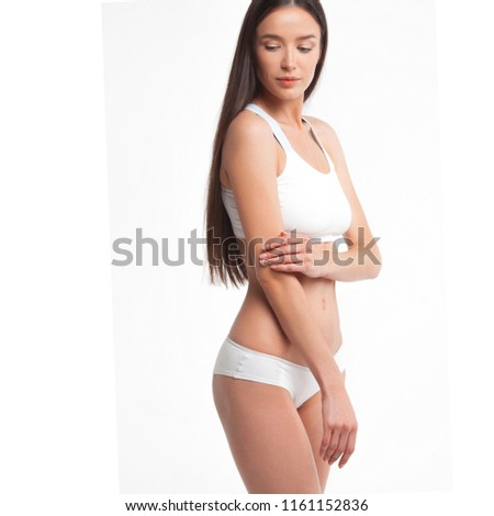 Slim young woman in underwear on white background. Skin and body care concept #1161152836