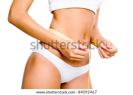 Slimming woman body in panties with measure on white background
