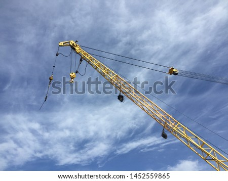 Sling hook , main hook at the end of the yellow crane boom. #1452559865