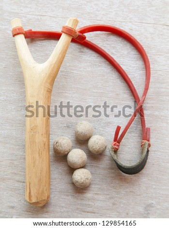 sling weapon with Clay pellets