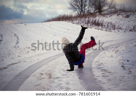 Slip on the slippery ice and snow on the road track at the country in freezing winter day