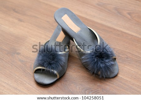 Slippers on the brown parquet floor - stock photo