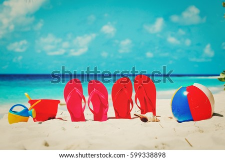 slippers, toys and diving mask at beach - Shutterstock ID 599338898
