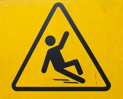 Slippery warning symbol and wet floors and another slip workplace hazards are everyday issues that need to be carefully handled to avoid falls, mishaps, and unnecessary visitor or employee injuries.