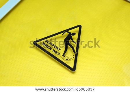 tattoo designs slippery when wet sign. Black Bedroom Furniture Sets. Home Design Ideas