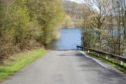 slipway for boat trailers at the Biggesee reservoir, Germany