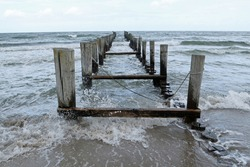 Slipway with wooden piles in the rough sea on a windy day; Zingst, Baltic Sea, Germany, Europe