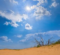 slope of sandy desert dune under a hot sparkle sun