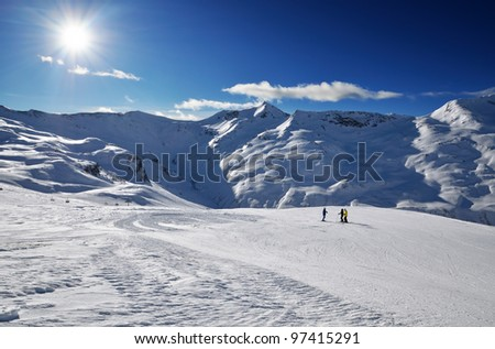 Slope on the skiing resort in Alps. Sunny winter day. Livigno, Italy