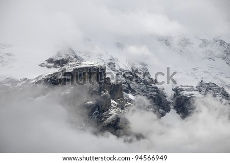 Slopes of Jungfrau seen through cloud