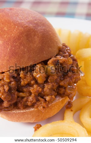 Sloppy joe sandwich served with curly fries.