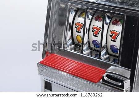 Slot machine and jackpot three seven on light background
