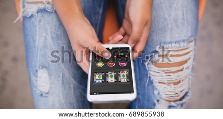 Slot machine on mobile display against woman using phone