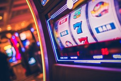 Slot Machine One Handed Bandit Game. Rolling Drums. Casinos and Gambling Industry.