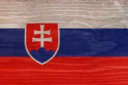Slovak flag with wood texture. Flag of Slovakia on a wooden texture
