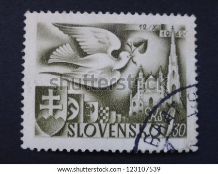 SLOVAKIA - CIRCA 1942: A stamp printed in Slovakia shows a dove and St Stephen's Cathedral, circa 1942.