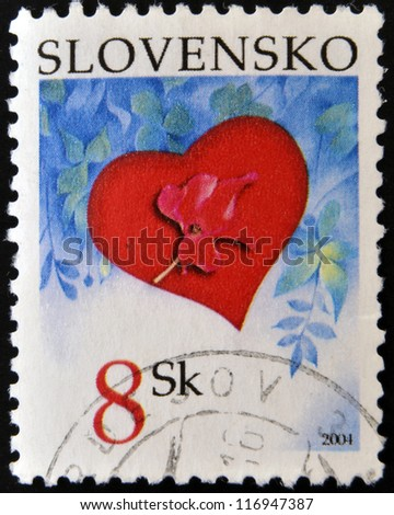 SLOVAKIA - CIRCA 2004: A stamp printed in Slovakia shows a poppy on a red heart, circa 2004