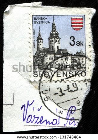 SLOVAKIA - CIRCA 1994: Postage stamp printed in Slovakia shows town Banska Bystrica, circa 1994 - stock photo